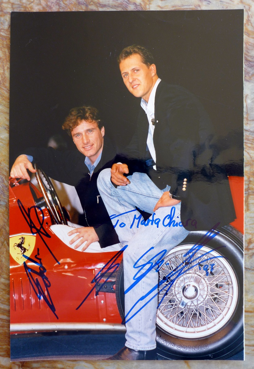 Schumacher and Irvine original signed photo